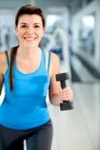 10957236-beautiful-woman-at-the-gym-exercising-with-free-weights