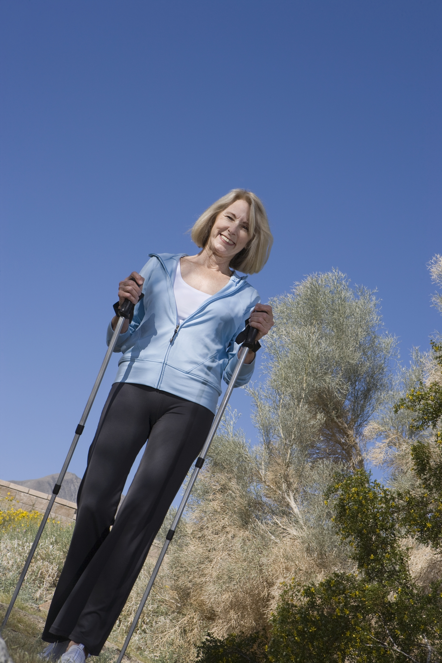 http://www.dreamstime.com/stock-photography-mature-woman-walking-poles-image29664582
